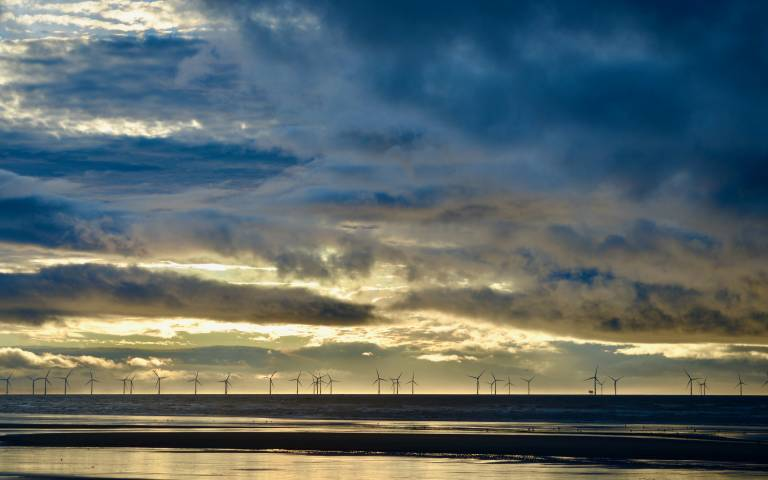 Offshore wind turbines with dramatic sky