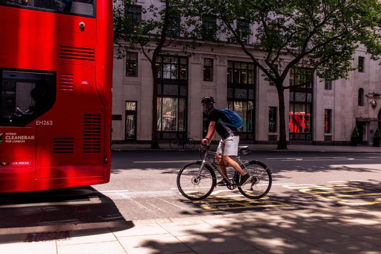 Bus and bike rider