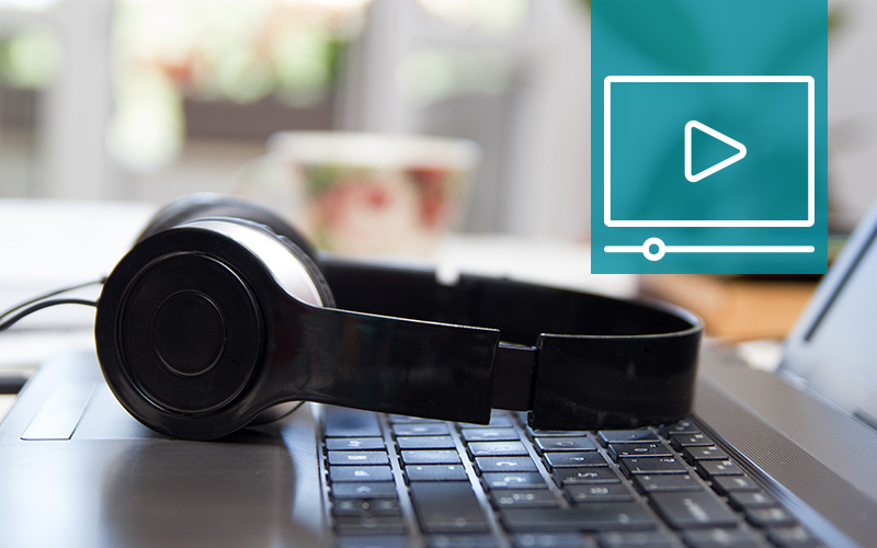 Image of headphones and laptop