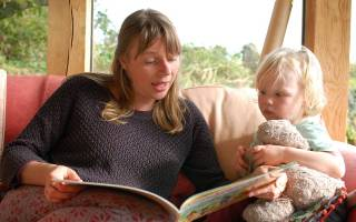 Mum reading to a child