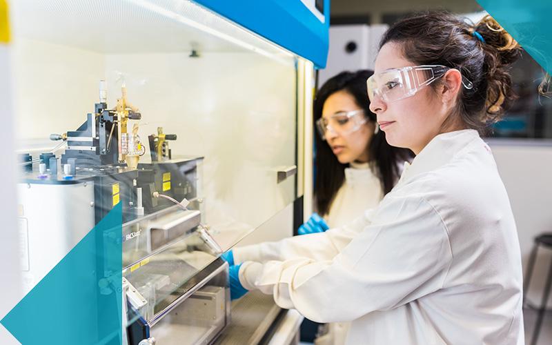 Biochemical engineering researchers at fume hood