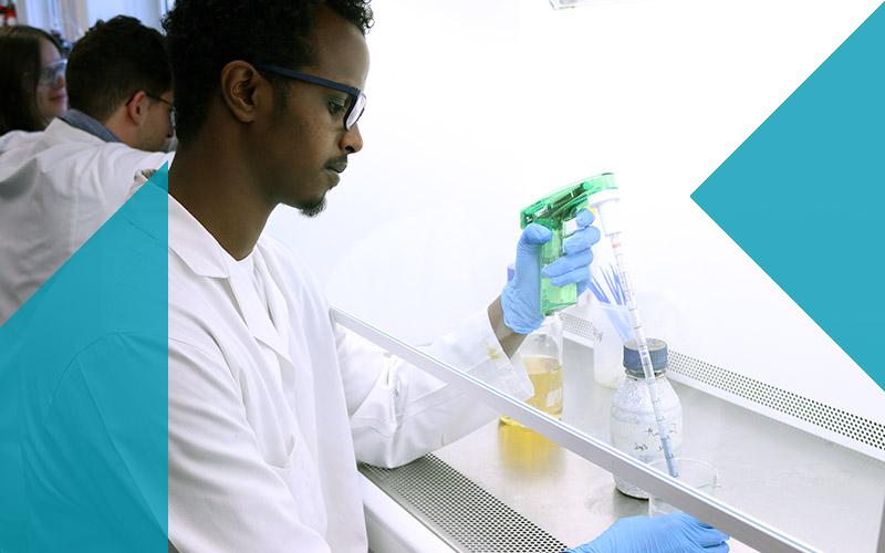Biochemical Engineering student at fume hood