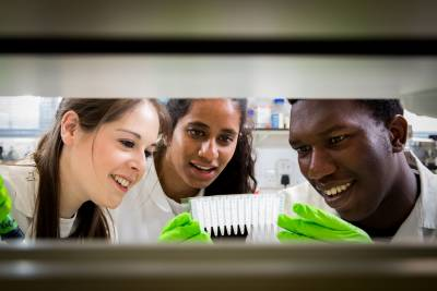 three students in biosciences lab
