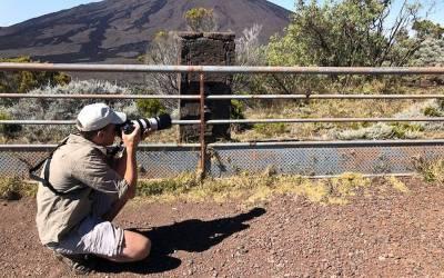 man_with_zoom_lens_on_camera_taking_photo_-_newsletter_-_tim_blackburn