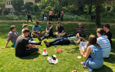 group of students in a green outside park