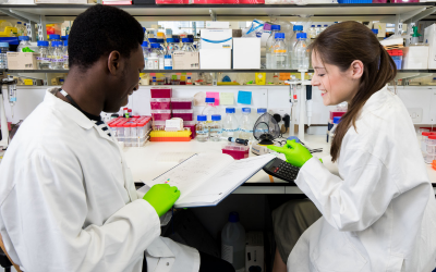 two students in a scientific lab