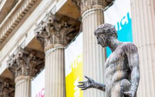ucl portico columns with colourful banners and statue