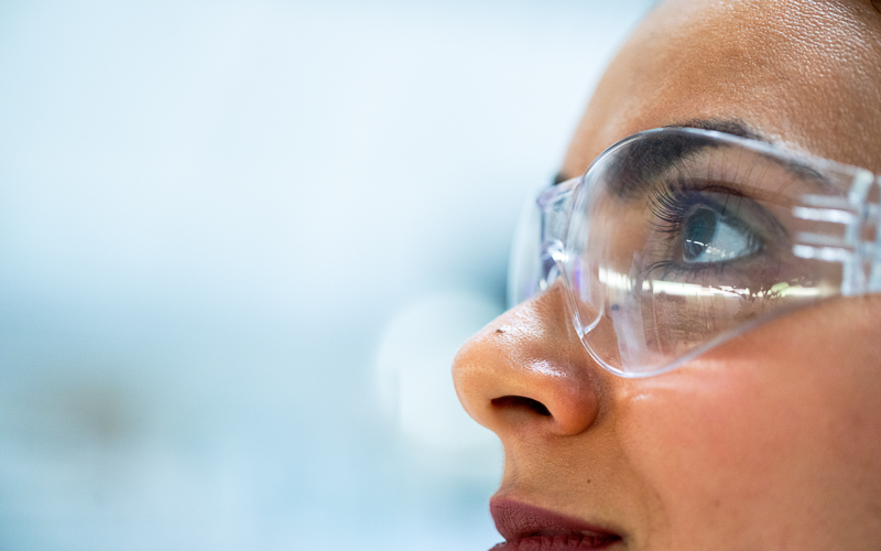 woman wearing safety glasses in a lab