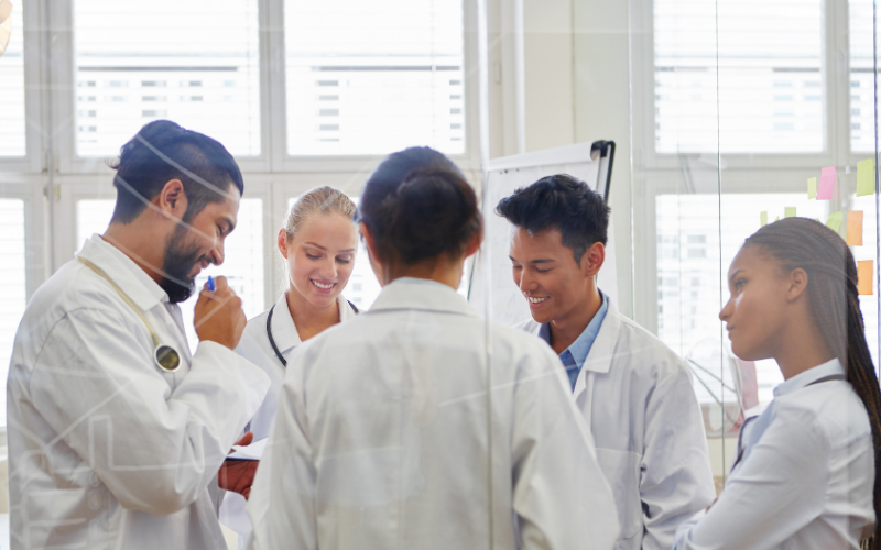 group of students in white lab coats