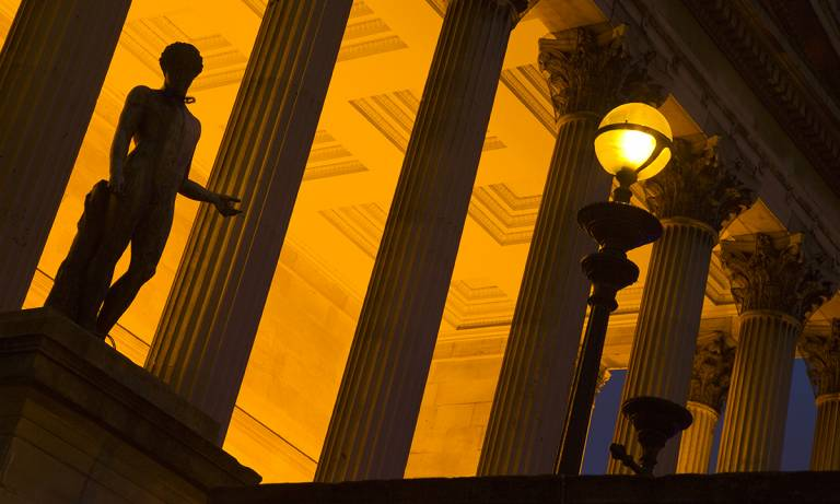 UCL Portico lit up at night