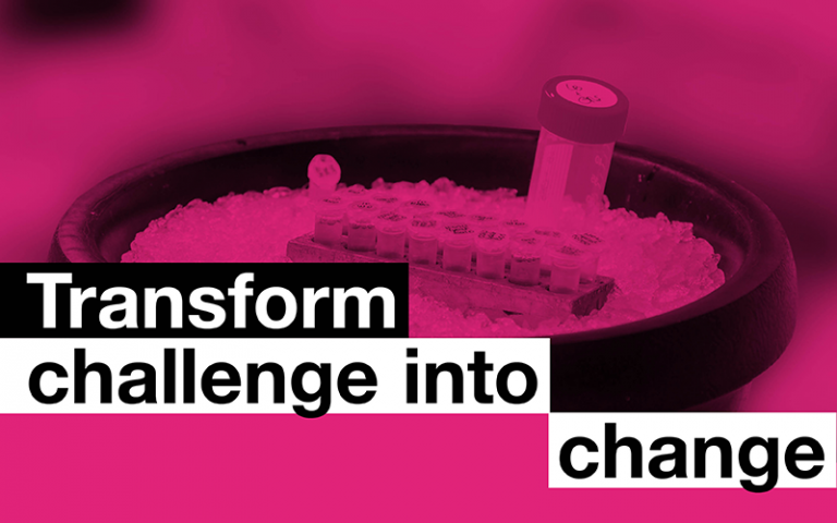 The words 'Transform over change' overlaid on a petri dish