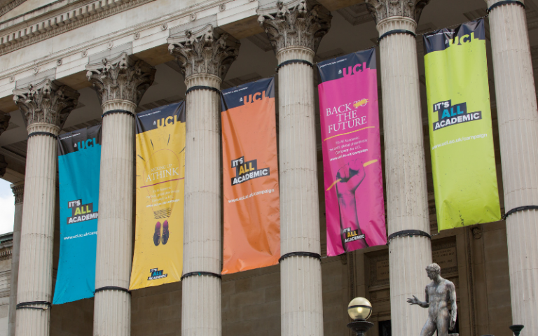 UCL Portico with It's All Academic Campaign flags