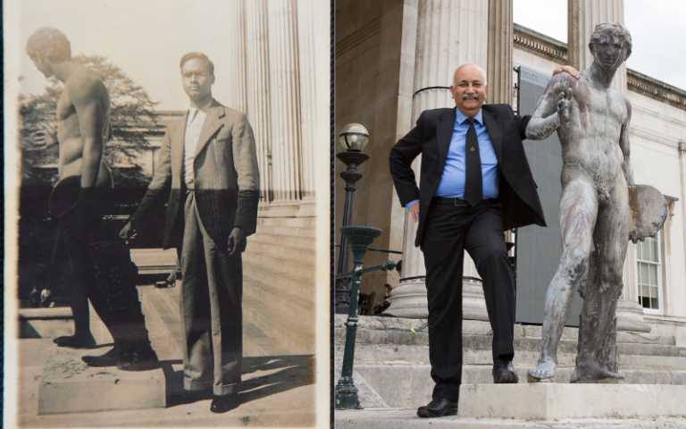 Gopal and his father Krishnan posing beside statues outside Portico