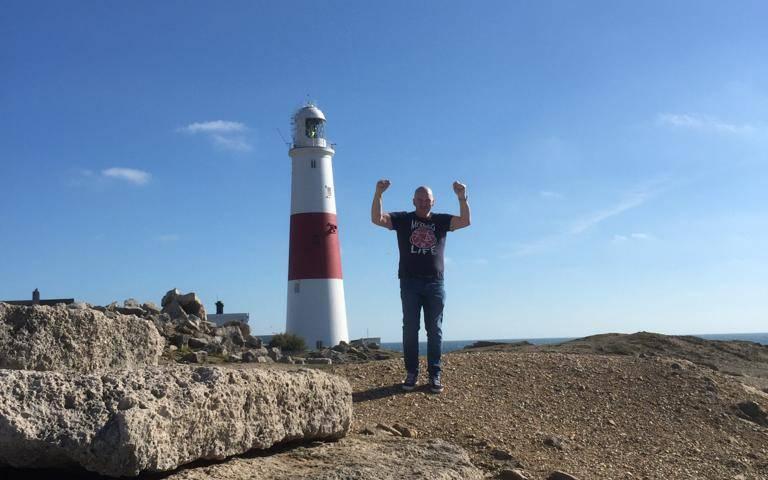 Scott Davies by a lighthouse