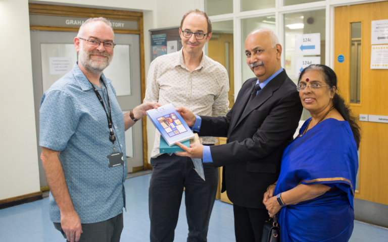 Professors Andrea Sella and Dewi Lewis with Gopal and Latika