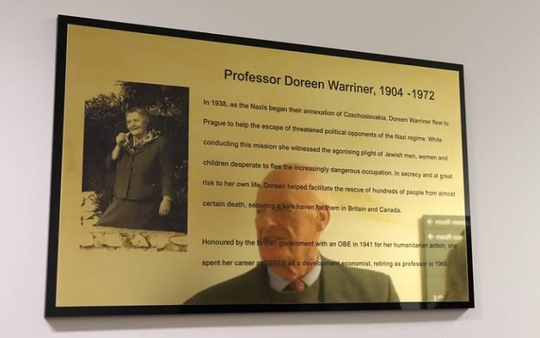 Henry Warriner reflected in the plaque to Doreen Warriner