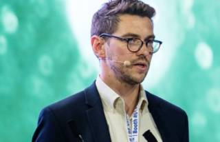 James Reading speaking at a conference