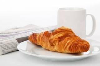 croissant, newspaper and mug