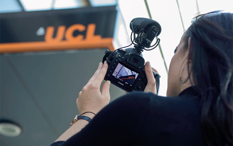 Woman taking picture with a camera