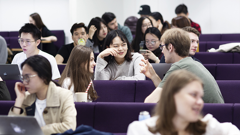 Students sat in a lecture theatre listening to their lecturer