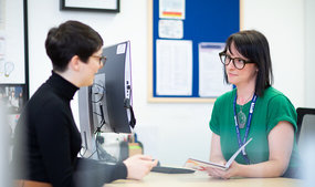 Student sat opposite Careers staff having a one-to-one appointment