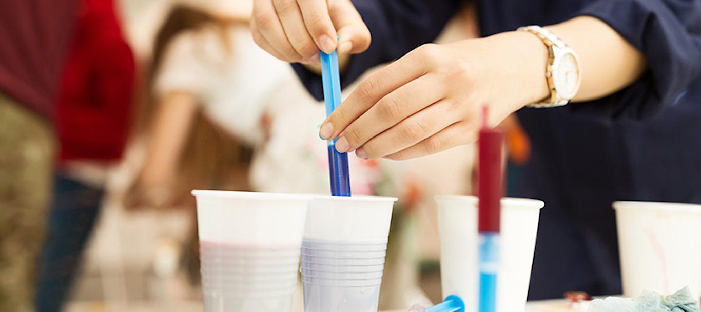 Volunteers working with paints