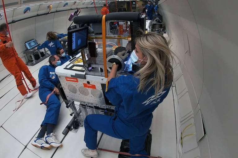 Malica Schmidt, a UCL PhD student, performing experiments in microgravity aboard a parabolic flight.