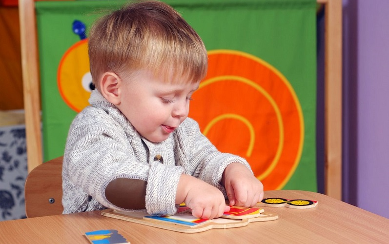 child playing with jigsaw
