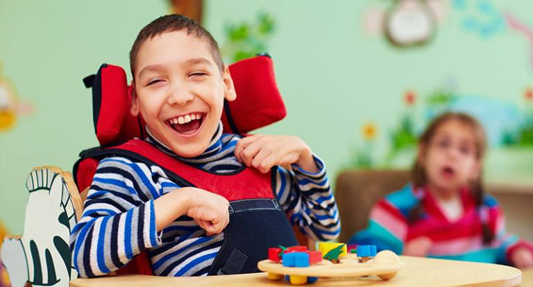 Boy smiling in learning environment