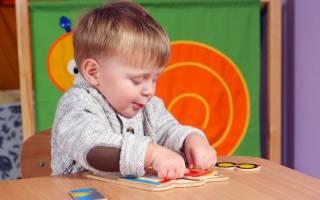 child with jigsaw