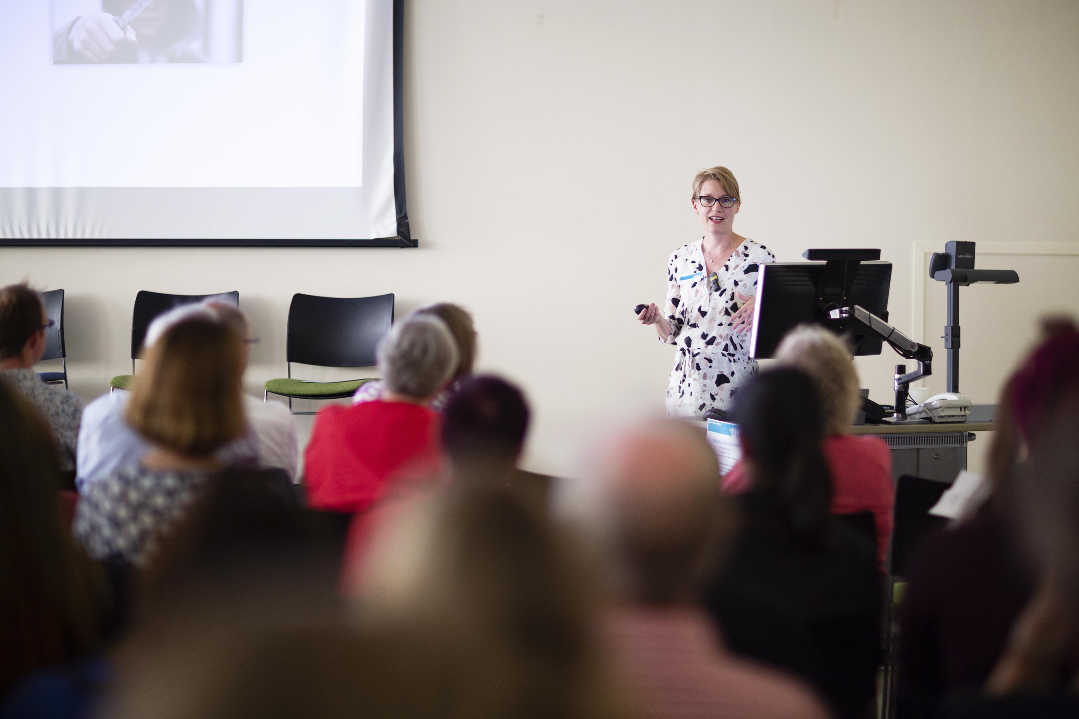 Essi Viding giving a presentation