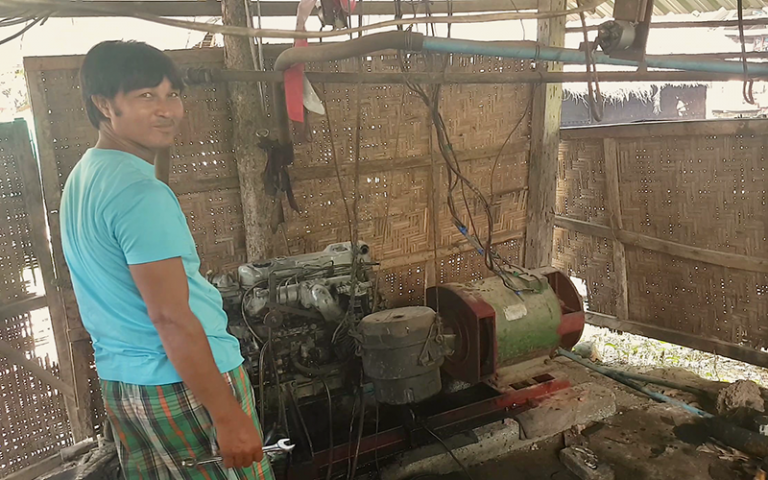 Aung Moe Win, one of Myanmar's rural electricians, or meesayars, with his village's electricity generator which he created himself 20 years ago. Photo credit: Mee Panyar