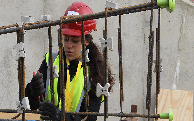 A civil engineering student working on steel reinforcement for the bridge piers at Constructionarium 2018.