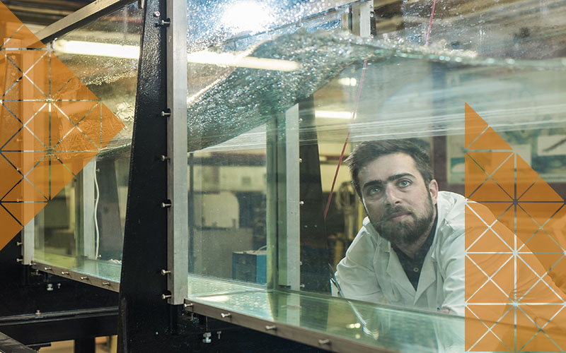 A student gazing into a fluid tank.
