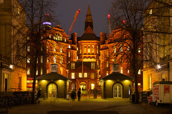 The Cruciform Building in UCL's Bloomsbury Campus at night.