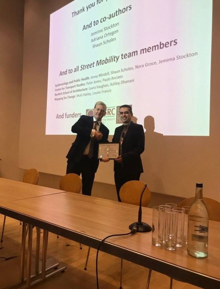 Prof David Lomas presenting CEGE's Dr Ancieas with the UCL Excellence in Health Research Award 2019