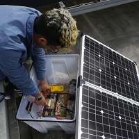 student with solar panel