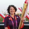 Thumbnail: Valerie Hazan holds the Olympic torch