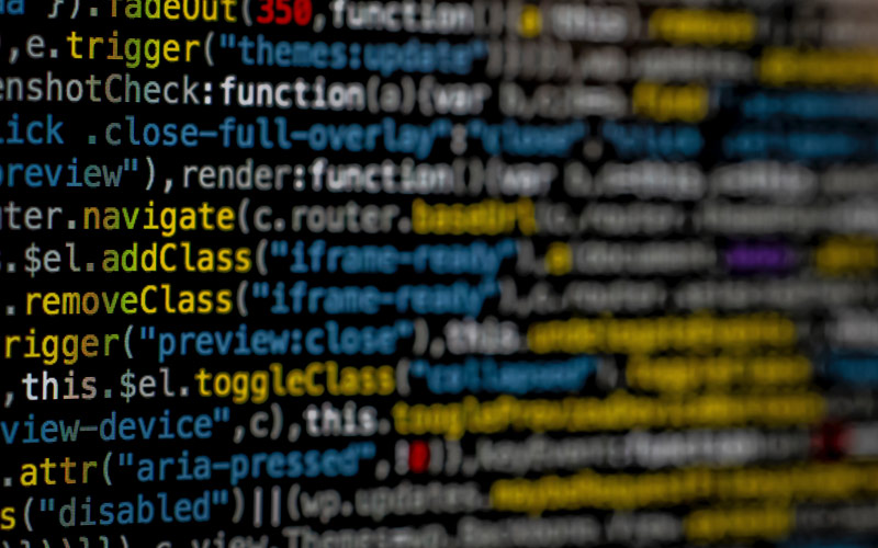 A close up of code on a computer screen in blue and yellow