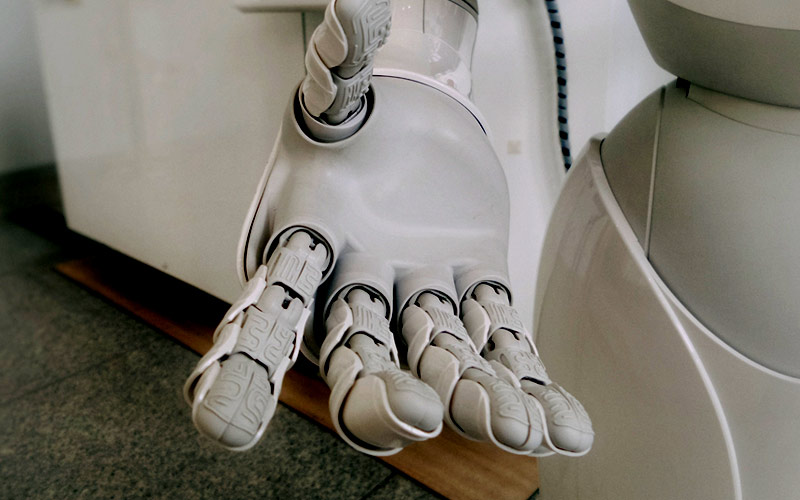 A close-up of a robot's hands, outstretched