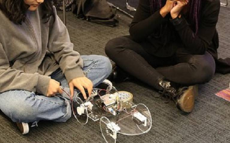 Female student with robotics equipment