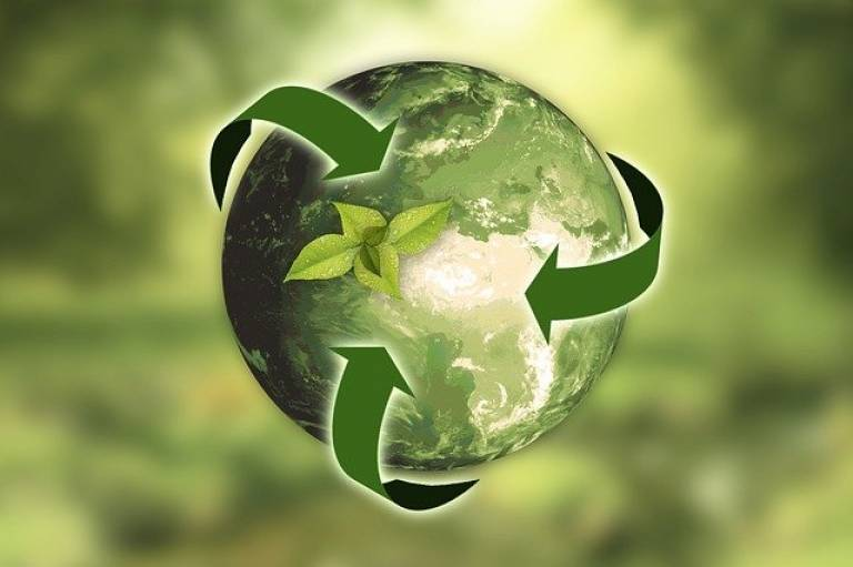 Green image featuring green globe, and recycling arrows