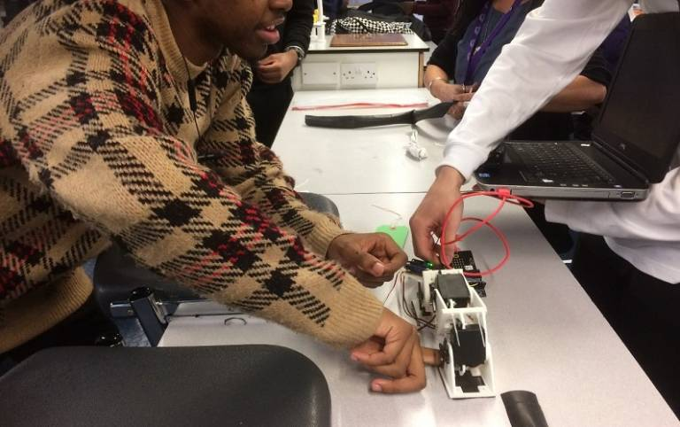 students experimenting with a robotics device