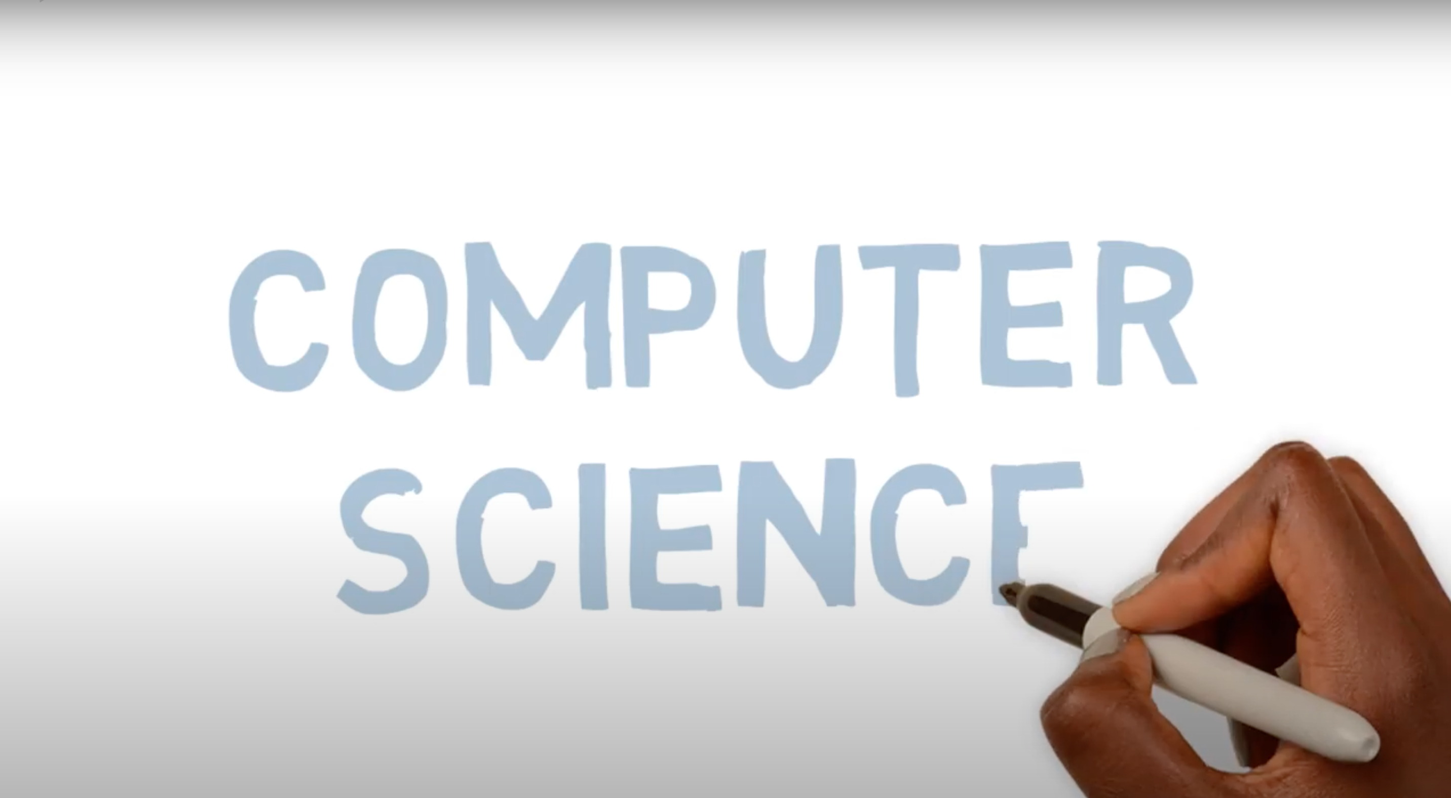 hand writing the words 'computer science' on a screen