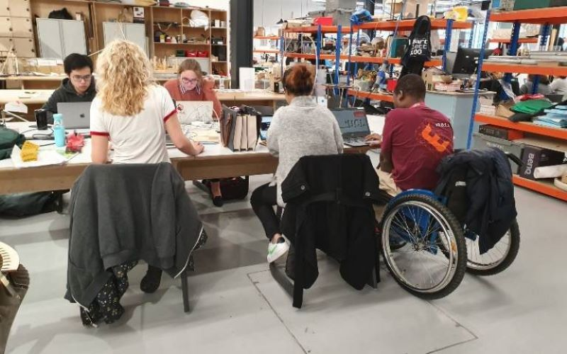 Image of students sitting around a table leading onto the disability support subgroup page