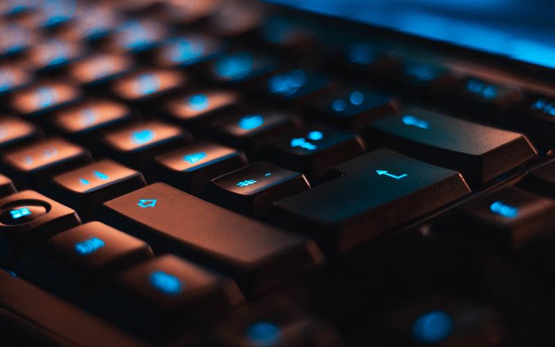 A close-up of a blue-lit keyboard