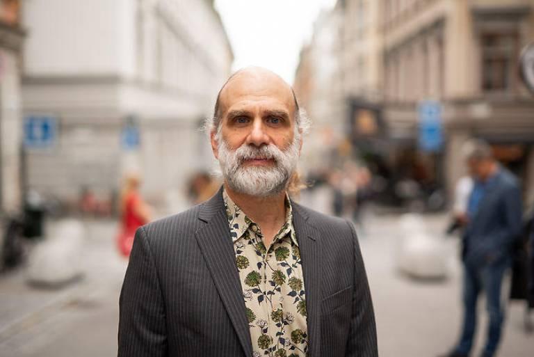 Photo of Bruce Schenier against blurred background