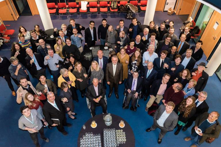 Peter Kirstein surrounded by friends, family and colleagues