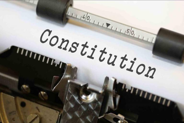 """The word """"Constitution"""" written on a typewriter"""