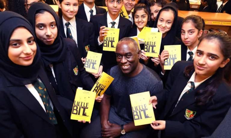YA author Alex Wheatle, pictured with pupils at Yardleys School, Birmingham